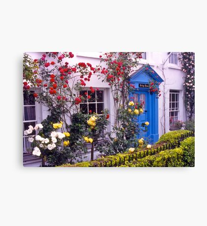 Entrance, English cottage, roses. UK Canvas Print