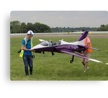 Model aircraft being carried after a display at the Festival of Flight in Biggin Hill Canvas Print