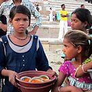 Varanasi, Candle sellers at sunset. by John Dalkin