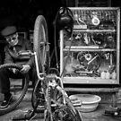 The Bicycle Man #0102 by Michiel de Lange