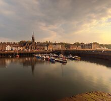 Sun begins to set over Newhaven Harbour, Edinburgh by Miles Gray