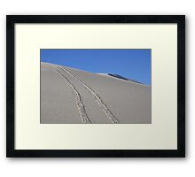 Tracks in the sand Framed Print
