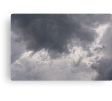 Fluffy stormy clouds. Canvas Print