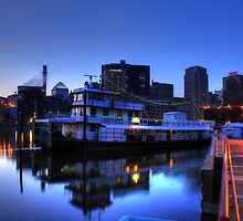 Tugboat at Night by Jimmy Ostgard