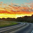 Sunrise On A Country Road by James Brotherton