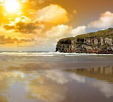 Ballybunion beach and cliffs wth Atlantic sunset by morrbyte