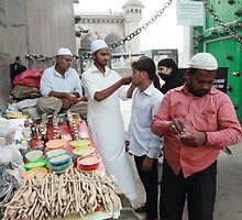 Vendor at Main Entrance Mecca Masjid  Mosque by Andrew  Makowiecki