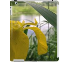 Yellow flower over river  iPad Case/Skin