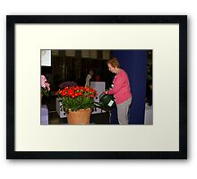 Watering the flowers at RHS Chelsea Flower Show Framed Print