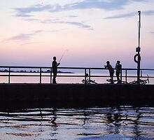 Boys Fishing On A Pier by Mark  Keeler
