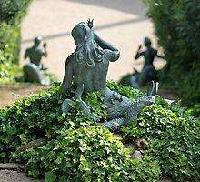 Statue  mermaid in the bush by mrivserg
