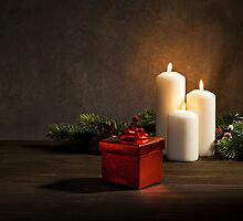 Candles and a present  with burning candles  by 3523studio