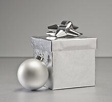 Silver bauble and present in Christmas setting by 3523studio