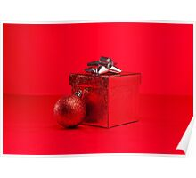 Red bauble and present in red Christmas setting Poster