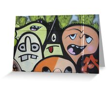 cartoon faces including triangle man Greeting Card