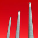 Energy - Three Smoke Stacks on a Red Background by Buckwhite