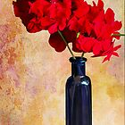 Red Geraniums in a Blue Vase by Diane Schuster