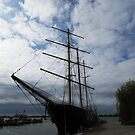 Tall Ship Framed By Clouds by Marie Van Schie