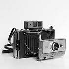 Vintage Polaroid Camera by Maren Misner