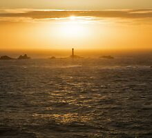 Longships Lighthouse at sunset by Ian Middleton