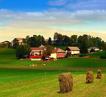 Hay bales and country village | landscape photography by Patrick Jobst