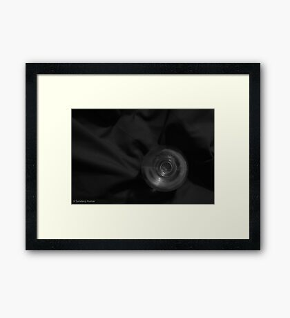 Empty Bottle and Red Cloth Framed Print
