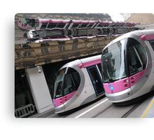 Four trams, one shot Canvas Print