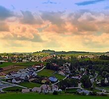 Beautiful village skyline beyond cloudy sky | landscape photography by Patrick Jobst