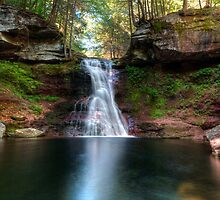 Spring Glow Highlights Sullivan Falls by Gene Walls