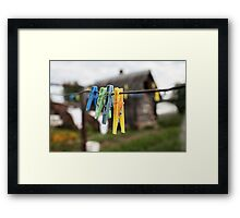 colorful clothespins Framed Print