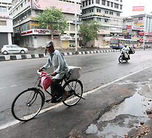 Cyclists in Abids Street Hyderabad by Andrew  Makowiecki