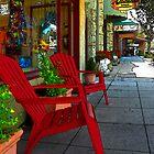 Chairs On A Sidewalk by James Eddy