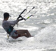 Close-up of male kite surfer in cap by Nick Dale