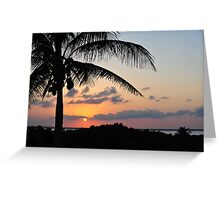 Tropical sunset with red sky, clouds and coconut tree silhouette Greeting Card