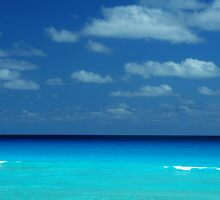 Tropical ocean view in the middle of sunny day in Cancun Mexico by Anton Oparin