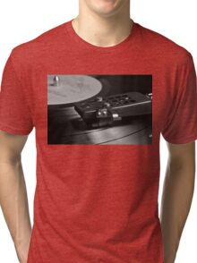 Vinyl record playing on a turntable Tri-blend T-Shirt