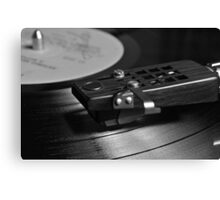 Vinyl record playing on a turntable Canvas Print