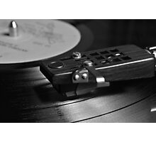 Vinyl record playing on a turntable Photographic Print