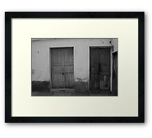 Wood Doors in a Wall Framed Print