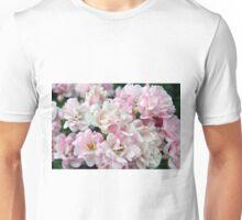 Beautiful small light pink flowers in the garden. Unisex T-Shirt