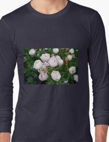 Beautiful small light pink flowers in the garden. Long Sleeve T-Shirt