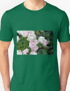 Beautiful small light pink flowers in the garden. Unisex T-Shirt