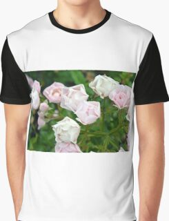 Beautiful small light pink flowers in the garden. Graphic T-Shirt