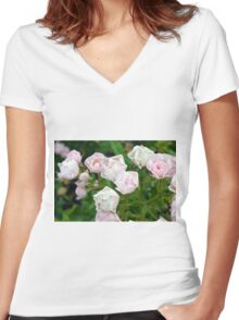 Beautiful small light pink flowers in the garden. Women's Fitted V-Neck T-Shirt