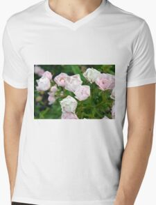 Beautiful small light pink flowers in the garden. Mens V-Neck T-Shirt