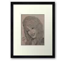 an American singer-songwriter, actress, author, businesswoman, and humanitarian, known primarily for her work in country music Framed Print