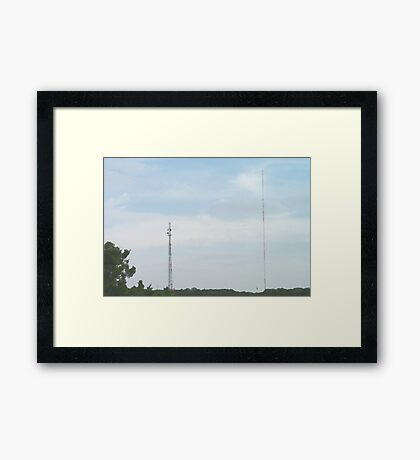 Two Radio Towers in the Distance Framed Print
