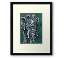 Painted elephant - white paint, on green Framed Print