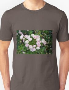 Small pale pink flowers and green leaves. Unisex T-Shirt