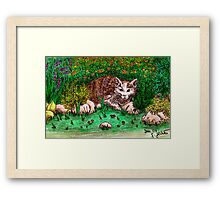 Cat in flower garden Framed Print